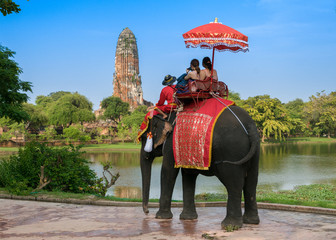 Tourists on an elephant ride tour of the ancient city Ayutaya ,thailand