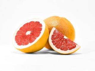 Isolated fruit photo Whole orange grapefruit with half and slice of ripe grapefruit are lying on a white background Close-up fruit photo
