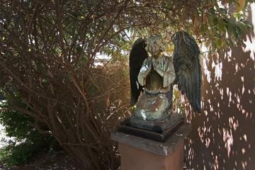 Bronze angel praying