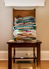Folded End of Quilts on Kitchen Chair