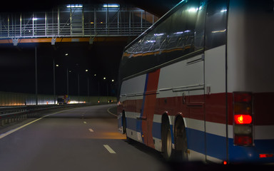 Bus Moves Over Night Highway