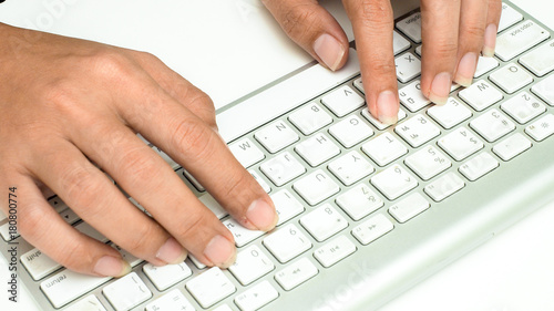 Wall mural keyboard with hand on white background