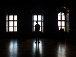 Silhouette of a man in the contra light