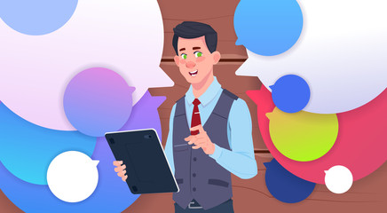 Businessman Holding Tablet Speak Over Colorful Chat Bubbles Flat Vector Illustration