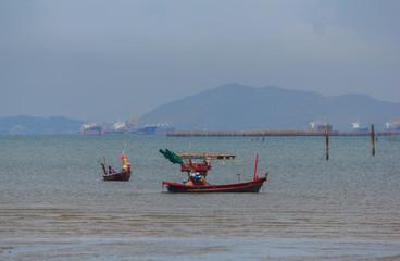Fishing boat on the sea shore.