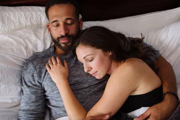 Couple cuddling and sleeping