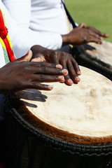 African drummer playing a djenbe