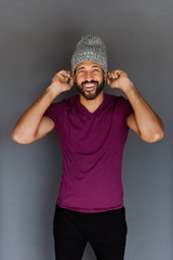 Young fit african model posing for the camera in the studio on a seamless background