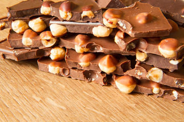 Dark and milk chocolate with hazelnut on a wooden background