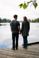 Couple holding hands on the dock