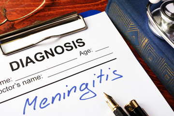 Diagnosis Meningitis written in a document on a table.