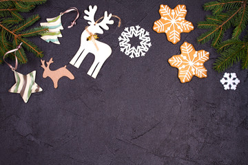 Christmas and New Year border or frame on black background. Winter holidays concept. View from above, top studio shot, horizontal