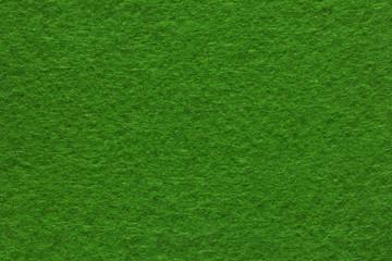 Green felt texture . Close up