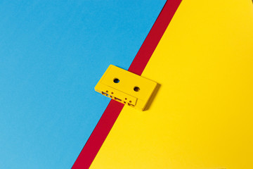 Yellow Audio Cassette Tapes On Colored Background, Isometric View. Creative Concept Of Retro Technology