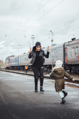 Mother and daughter at the train station