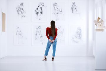 Fashionable woman looking at display