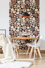 Table with chairs with wallpaper in the wall