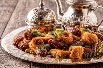 Eastern sweets on old wooden table.