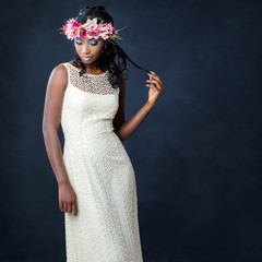 Stylish portrait of african bride with flower crown.