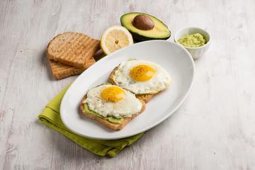 eggs over avocado cream and toasted bread