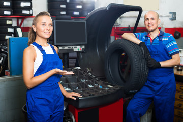Two technicians working in car service