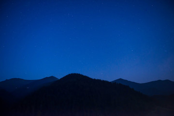 Silhouette of mountain range at night