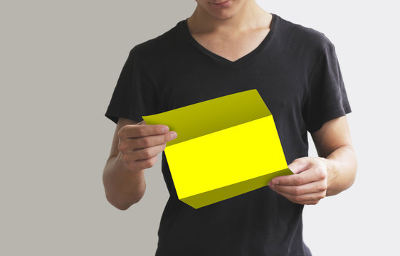 Man reading blank yellow flyer brochure booklet. Leaflet presentation. Pamphlet hold hands. Man show clear offset paper. Sheet template.