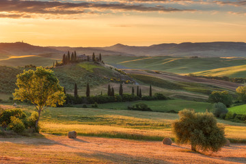 Printed roller blinds Khaki Magnificent spring landscape at sunrise.Beautiful view of typical tuscan farm house, green wave hills, cypresses trees, hay bales, olive trees, beautiful golden fields and meadows.Italy, Europe