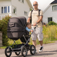 Dad drives his son in baby carriages