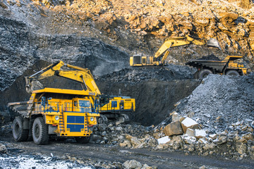 type of coal quarry with working machinery