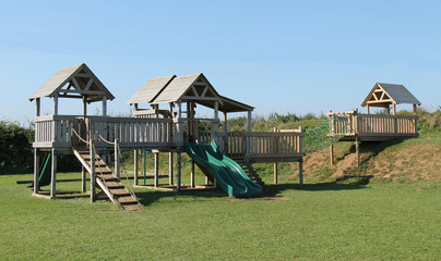 Large Wooden Activity Centre at a Childrens Playground.
