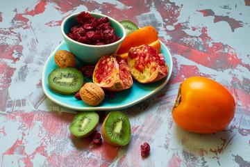 Persimmon, pomegranate, kiwi cranberries
