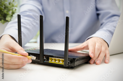 Surprising Man Plugs Ethernet Cable Into Router Router Wireless Wire Broadband Wiring 101 Tzicihahutechinfo