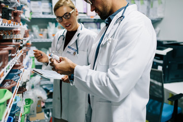Pharmacists checking inventory at pharmacy