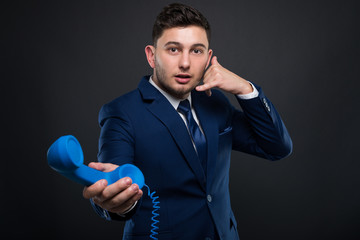 Successful director gesturing a call sign