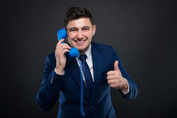Young executive manager at the phone