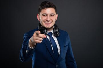 Joyful male entrepreneur with headphones