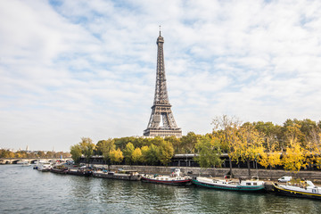 Paris, France - November, 2017. Seine in Paris with Eiffel tower on blue sky