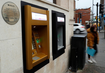 A gold coloured ATM is seen as it commemorates the location of the world's first cash machine in London