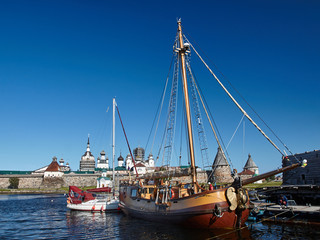 Two sailing ship in front of Ancient Solovetsky Monastery