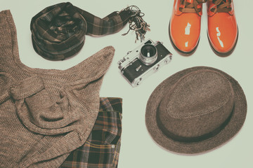 British fashion style women outfit with vintage film camera