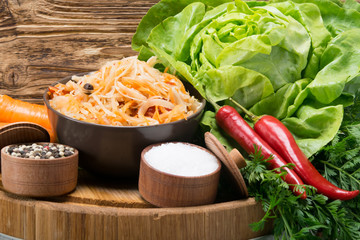 ready cabbage salad in a plate, next to a set of products
