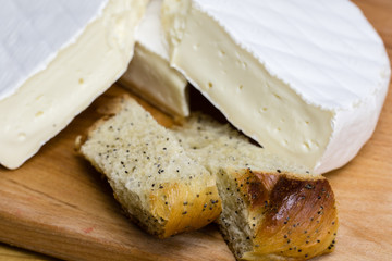 Fresh pastry with poppy seeds excellently paired with Camembert cheese brie .