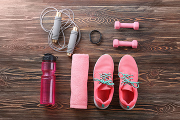 Composition with towel and sport equipment on wooden background