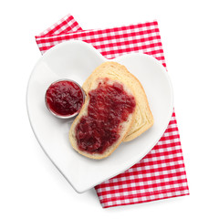 Gravy boat and bread with strawberry jam on plate, isolated on white