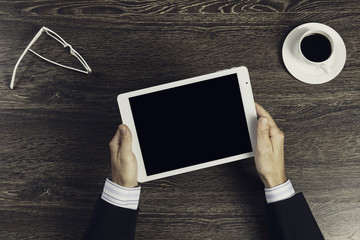 Tablet pc with blank screen in hands