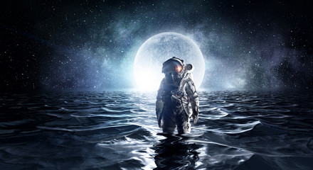 Spaceman in the sea. Mixed media Fototapete