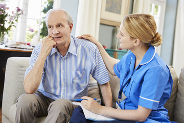 Community Nurse Visits Senior Man Suffering With Depression