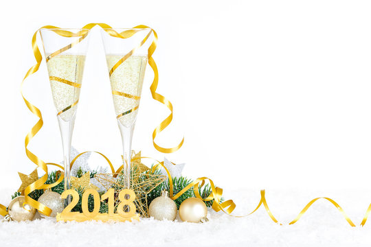 New Year Celebration with Champagne Glasses 2018. New Year golden ribbon flutes with bubbling champagne.