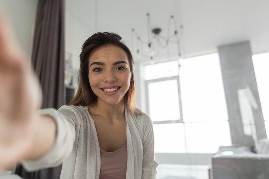 Beautiful Girl Taking Selfie Portrait Photo In Bedroom In Morning Happy Smiling In Camera